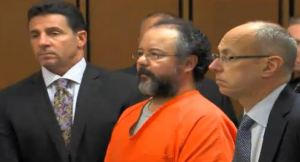 (Ariel Castro stands with his attorneys as the judge addresses him following his sentencing.)