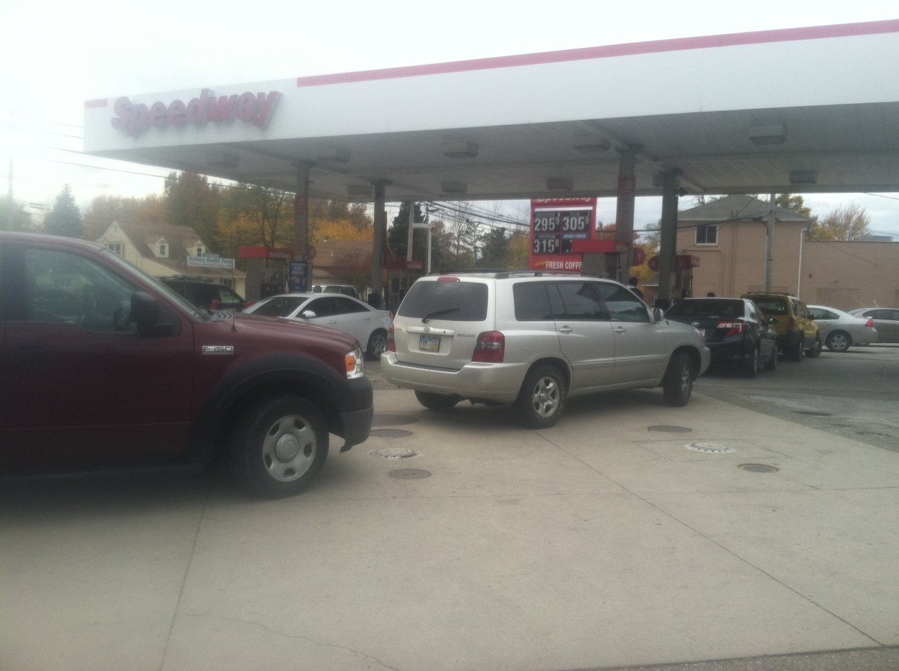 (Customers line up for cheap gas in Lorain on Nov. 6, 2013)