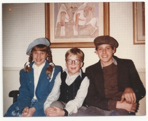 FOX 8's Stefani Schaefer and her brother sit with Peter Billingsley on the set of 'A Christmas Story.'