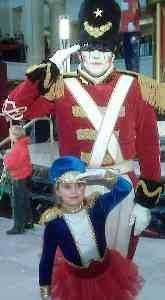 Missy's daughter posing with the Toy Soldier in 2008