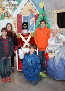 Missy's four children  pose with the Toy Soldier after the show this year.