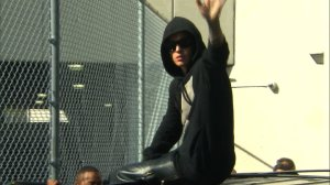 Justin Bieber waves to fans after being released from a Miami, Florida jail Thursday, January 23, 2014. (Credit: CNN)