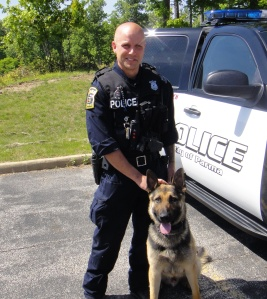 K-9 Officer Coney and his handler, Officer Schuld (photo courtesy of Parma police)
