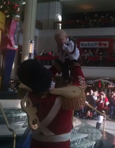 The Toy Soldier lifts up Stoyka's 6-month-old son.