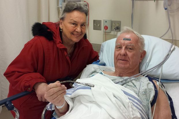 Arthur Lampitt and his wife holding the turn signal part removed from his arm. Courtesy Jesse Bogan via St. Louis Dispatch.