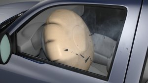 This graphic from the Insurance Institute for Highway Safety shows an airbag expanding, shooting shrapnel toward the driver. (Courtesy: IIHS via CNN)