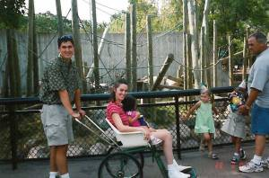 Jean's husband Steve Abbott pushes her in a stroller at the zoo. Photo credit: Jean Abbott via Tribune Media Wire