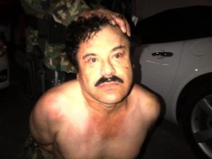 "A manhunt was launched to find Mexican drug kingpin Joaquin ""El Chapo"" Guzman after he escaped from prison, Mexico's National Security Commission said in a statement Saturday, July 11, 2015. Guards at the Altiplano Federal Prison found that Guzman was missing during routine check. This photograph shows Guzman during a February, 2014 arrest. (Mexican Law Enforcement)"