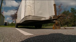 Troopers say the cyclist hit in between a pick-up truck and the trailer it was towing.