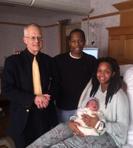 Rev. Wayne Decker with Jamaal, Monique and Zuri Chavers (Photo courtesy: University Hospitals)