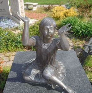 An empty-handed statue to the memory of children after the theft of the butterflies it used to hold. (Photo courtesy: Willowick Police)