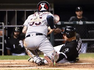 CHICAGO, IL - SEPTEMBER 12: Avisail Garcia #26 of the Chicago White Sox is safe at home as Roberto Perez #55 of the Cleveland Indians makes a late tag during the second inning on September 12, 2016 at U.S. Cellular Field in Chicago, Illinois. (Photo by David Banks/Getty Images)