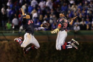 CHICAGO, IL - OCTOBER 28:  Francisco Lindor #12 and Rajai Davis #20 of the Cleveland Indians celebrate after defeating the Chicago Cubs 1-0 in Game Three of the 2016 World Series at Wrigley Field on October 28, 2016 in Chicago, Illinois.  (Photo by Jamie Squire/Getty Images)