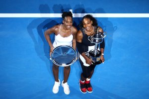 MELBOURNE, AUSTRALIA - JANUARY 28:  Serena Williams of the United States poses with the Daphne Akhurst Trophy alongside Venus Williams of the United States, posing with the runners up plate  after the Women's Singles Final on day 13 of the 2017 Australian Open at Melbourne Park on January 28, 2017 in Melbourne, Australia.  (Photo by Cameron Spencer/Getty Images)