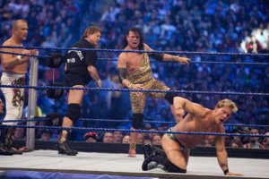 "HOUSTON, TX - APRIL 5: (L-R) Former professional wrestlers Ricky ""The Dragon"" Steamboat and ""Rowdy Roddy Piper look on as Jimmy ""Superfly"" Snuka steps into the ring to battle WWE Superstar Chris Jericho during WrestleMania 25 at Reliant Stadium on April 5, 2009 in Houston, Texas. (Photo by Bill Olive/Getty Images)"