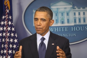 Obama talks with reporters in White House briefing room