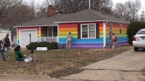Volunteers paint house in gay pride rainbow colors
