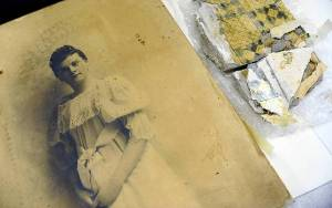 A vintage picture waits in a state warehouse to be cataloged.