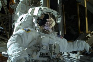 Astronauts complete first in a series of spacewalks