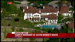 justin beibers home raided