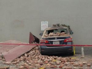 A car underneath earthquake debris in the Napa Valley