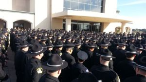 Sacramento County Sheriff's deputies file in to the church for Deputy Oliver's funeral.