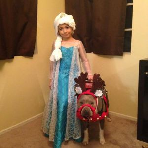 Abcde and her pet dog, pup-cake. They were turned away by a mall Santa in Orange County. Courtesy: Facebook.com/PupcakePitBullServiceDog