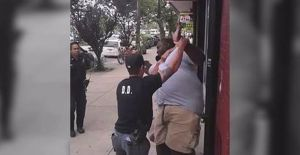 Cell phone video shows an officer holding Eric Garner in a chokehold. July 17, 2014