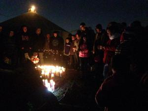 Image from a candlelight vigil held in honor of Carlitos Chavez