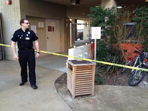 An officer stands guard near the roped-off emergency room.