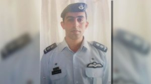 Photo of Jordanian pilot Moath al-Kasasbeh in uniform. ISIS militants claimed they captured al-Kasasbeh on Wednesday, Dec. 24, 2014 after claiming to have shot down a coalition warplane over Syria. Video and still images surfaced on Feb. 3, 2015, showing the pilot behing burned alive while confined in a cage. Courtesy: CNN