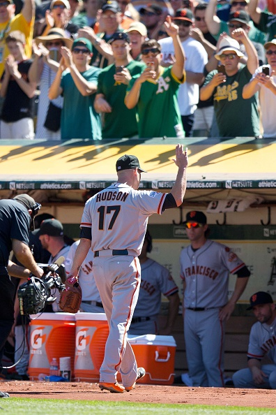 OAKLAND, CA - SEPTEMBER 26:  Tim Hudson #17 of the San Francisco Giants returns to the dugout after being relieved during the second inning against the Oakland Athletics at O.co Coliseum on September 26, 2015 in Oakland, California. (Photo by Jason O. Watson/Getty Images)