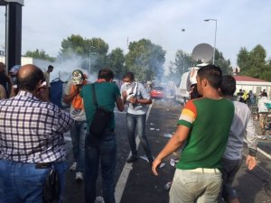 """Hungarian police say they responded with tear gas and water cannon when a group of """"aggressive"""" migrants broke through a border gate from Serbia on September 16, 2015 (Courtesy: Gul Tuysuz/CNN)"""