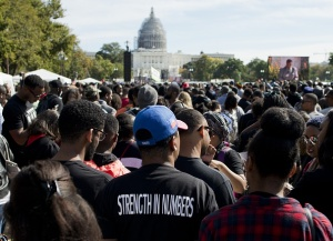 People listen to speeches during the Justice or Else! rally on the National Mall in Washington, DC on October 10, 2015. The rally commemorates the 20th anniversary of the Million Man March which took place on October 16, 1995.   AFP PHOTO/ ANDREW CABALLERO-REYNOLDS        (Photo credit should read Andrew Caballero-Reynolds/AFP/Getty Images)
