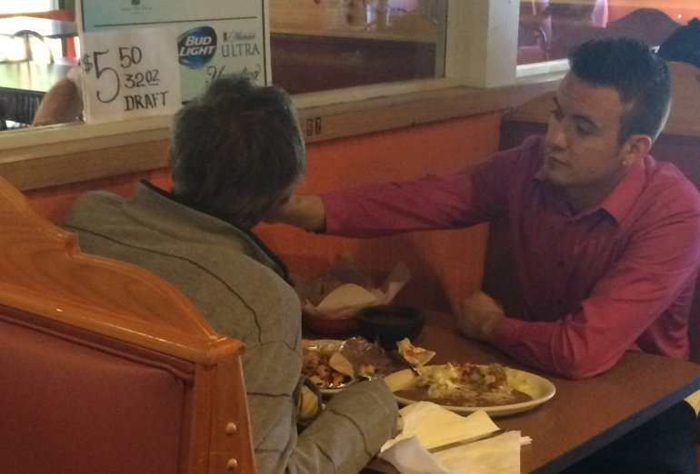 Alex Ruiz, a server at Cinco de Mayo restaurant in Douglasville, Georgia, went above and beyond his job — to feed a man without hands. (Courtesy: Courtesy of Reginald Widner via CNN)