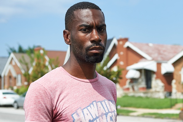 """Deray McKesson, an avid protestor and frontline activist, is seen in St. Louis, Missouri on August 7, 2015. McKesson is one of the most vocal activists since the Ferguson shooting of 18-year-old Michael Brown Jr. in August 2014. The seemingly endless stream of videos and stories showing brutal and outrageous behavior by police has forced the nation to acknowledge the reality of systemic racism, said DeRay Mckesson, an activist with We The Protesters who has nearly 200,000 Twitter followers. """"So much of the work in the past year was focused on exposing and convincing and saying to people 'this is what happened' and 'this is what's wrong', 'believe me and listen',"""" he told AFP. AFP PHOTO / MICHAEL B. THOMAS (Photo credit should read Michael B. Thomas/AFP/Getty Images)"""