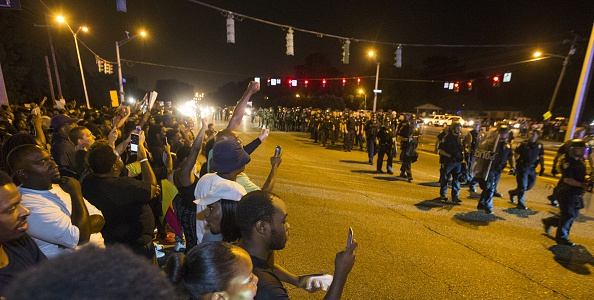 BATON ROUGE, LA -JULY 09: Baton Rouge police in riot gear move in on protesters for a second night in a row on July 9, 2016 in Baton Rouge, Louisiana. Alton Sterling was shot by a police officer in front of the Triple S Food Mart in Baton Rouge on July 5th, leading the Department of Justice to open a civil rights investigation. (Photo by Mark Wallheiser/Getty Images)