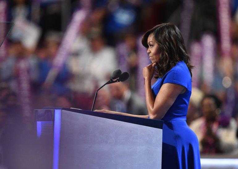 US First Lady Michelle Obama addresses delegates on Day 1 of the Democratic National Convention at the Wells Fargo Center in Philadelphia, Pennsylvania, July 25, 2016. / AFP / Robyn BECK (Photo credit should read ROBYN BECK/AFP/Getty Images)