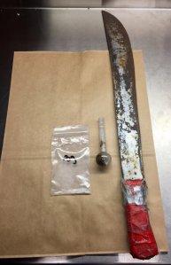 The machete and drug paraphernalia found on Valencia. (Courtesy: Fairfield Police Department)