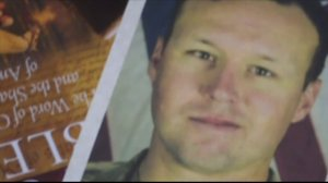 The slain soldier's family was booed on the American Airlines flight. (Credit: KTLA)