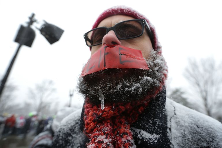 A pro-life activist stands in the snow as he covers his mouth with tape during the 2016 March for Life January 22, 2016 in Washington, DC. The annual event marked the anniversary of the Supreme Court Roe v. Wade ruling in 1973.  (Photo by Alex Wong/Getty Images)