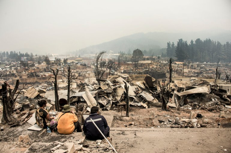 View of the remains of Santa Olga, 350 kilometres south of Santiago, after being devastated by a forest fire on January 27, 2017 Raging forest fires in central Chile have killed 10 people, displaced thousands and destroyed entire villages. Multiple blazes fueled by strong wind and drought conditions have ravaged 273,000 hectares (680,000 acres) in just over a week. / AFP / MARTIN BERNETTI (Photo credit should read MARTIN BERNETTI/AFP/Getty Images)