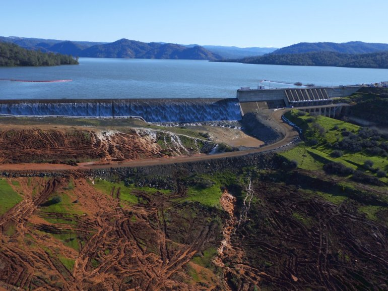 Water flows over the Oroville Dam's emergency spillway for the first time in the dam's history (Courtesy: DWR)