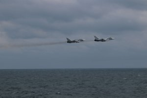 "The US military has released several photos of what it says were SU-24 Russian fighter jets ""buzzing"" the deck of a US warship in the Black Sea on February 10, 2017."