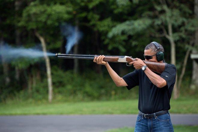 Pres. Obama takes in target preatice on the range at Camp David