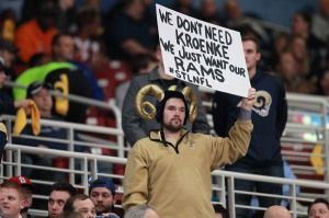 A St. Louis Rams fan holds a sign during a game against the Tampa Bay Buccaneers at the Edward Jones Dome in St. Louis on December 17, 2015. The Rams are playing their last home game of the season as rumors swirl that the Rams and owner Stan Kronke will move the club to Los Angeles at the end of the season. Photo by Bill Greenblatt/UPI