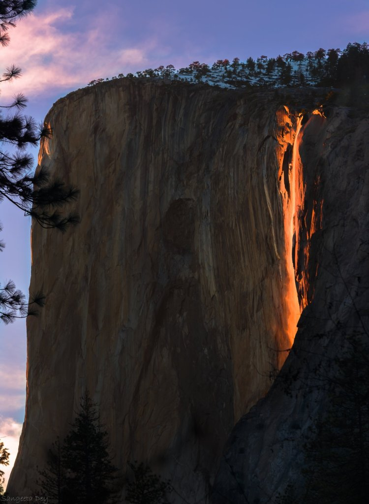 No, that is not lava flowing over a cliff.
