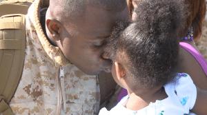 Marine father returns to daughter's hug