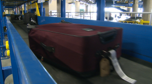Airport unveils new baggage screening system