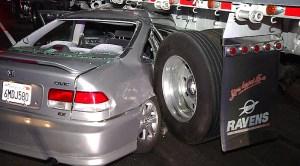 Car Wedged Under Big Rig